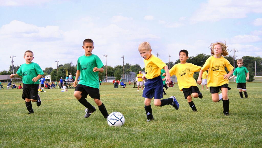 Playing sports gets the body moving and uses up energy | Image via Tysto / Wikimedia Commons